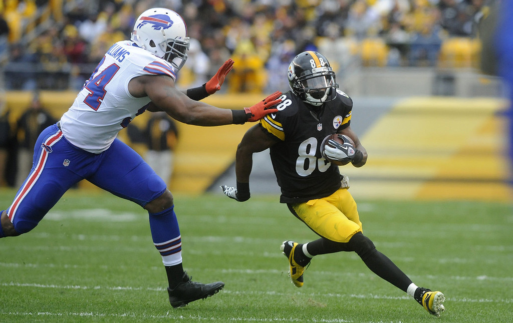 . Emmanuel Sanders #88 of the Pittsburgh Steelers is chased by Mario Williams #94 of the Buffalo Bills during the second quarter at Heinz Field on November 10, 2013 in Pittsburgh, Pennsylvania. (Photo by Vincent Pugliese/Getty Images)