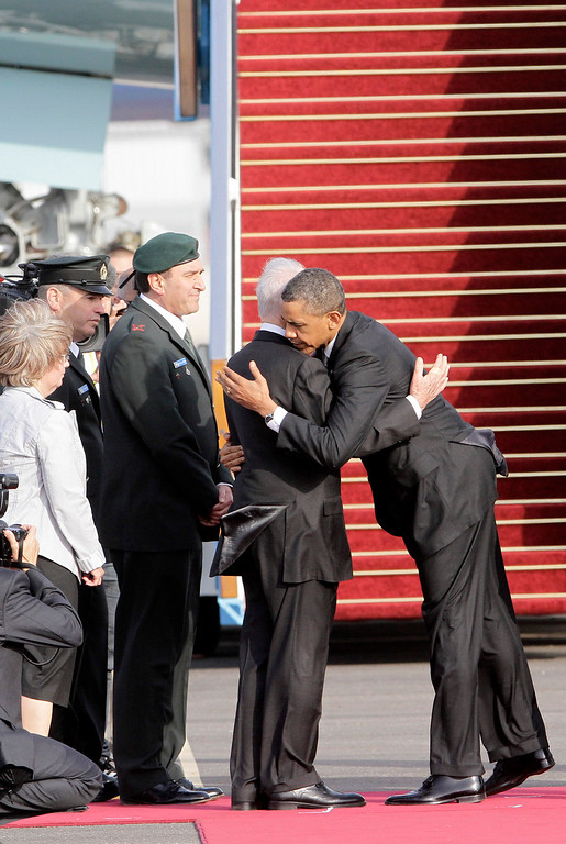 . US President Barack Obama (R) greets Israeli President Shimon Peres prior to departing from Ben Gurion International Airport in Tel Aviv, Israel, on March 22, 2013. Following a three-day trip to Israel and the Palestinian territories, his first as president, Obama will fly to Amman for talks and a private dinner with King Abdullah II, after wrapping up his trip to the Holy Land with a visit to Bethlehem\'s Church of the Nativity. AFP PHOTO YOSSI ALONI/AFP/Getty Images