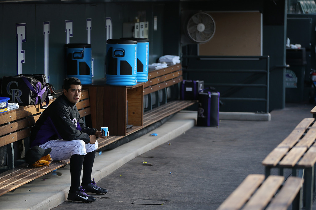. Starting pitcher Jorge De La Rosa #29 of the Colorado Rockies sits in the dugout prior to facing the San Francisco Giants at Coors Field on April 21, 2014 in Denver, Colorado.  (Photo by Doug Pensinger/Getty Images)