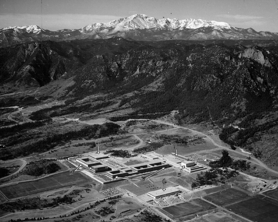 . In its nook against the Ramoart Range of the Rockies in 1960, the academy has the polished appearance it likes to see in its students. Numbers in the photo above locate these points: 1) Mitchell Hall (cadet dining room); 2) Fairchild Hall (academic-library build­ing); 3) Vandenberg Hall (dormitory; 4) Harmon Hall (administration building); 5) Arnold Hall, (social center); and 6) the physical education building. The Denver Post Library Archive