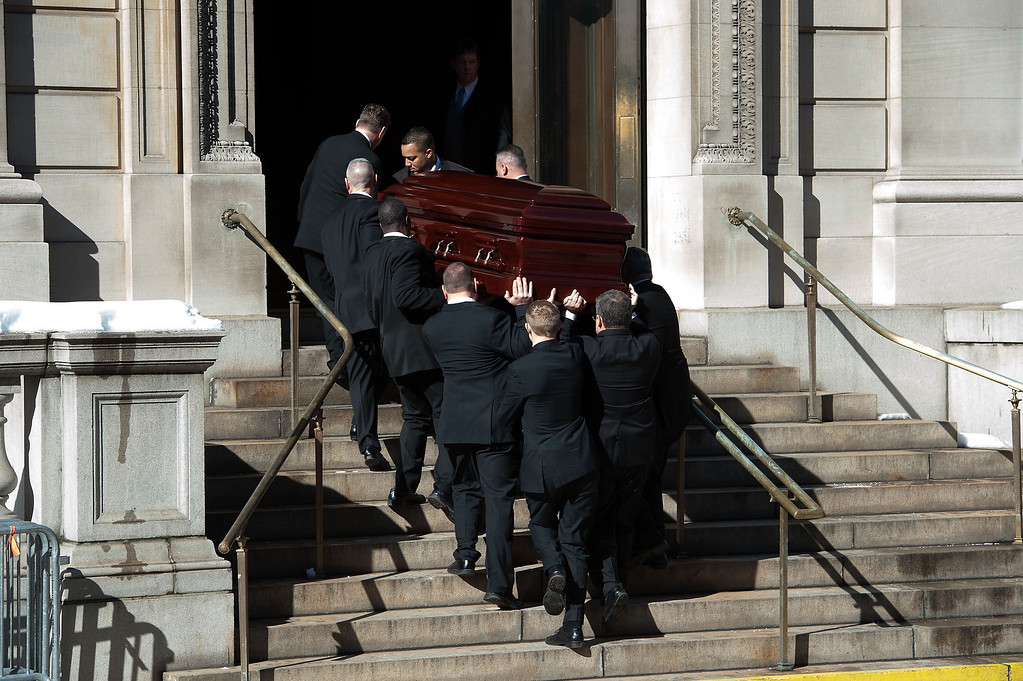 . Pallbearers carry Philip Seymour Hoffman\'s casket into St. Ignatius Of Loyola church during the funeral service for actor Philip Seymour Hoffman at St. Ignatius Of Loyola on February 7, 2014 in New York City. Hoffman died of an alleged drug overdose on February 1, 2014.  (Photo by D Dipasupil/Getty Images)