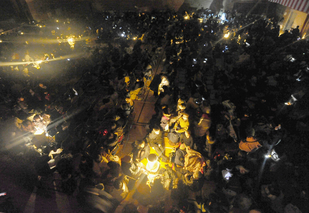 . People take shelter at a temporary evacuation center with no electricity Friday night, March 11, 2011 in Sendai, Miyagi Prefecture (state) after Japan was struck by a strong earthquake off its northeastern coast earlier in the day. (AP Photo/Kyodo News)