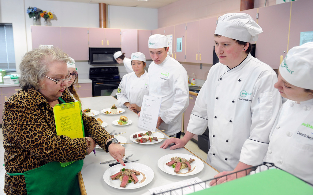 . Many area high schools are developing culinary classes. Standley Lake High School with teacher Valerie Baylie has a class called ProStart sponsored by the Colorado Restaurant Association. Baylie, left, talks to students  from left,  Emilio Balderas, and Danielle Benton, far right,   on Monday, April 22,  2013 about their beef dish.   (Photo By Cyrus McCrimmon/The Denver Post)
