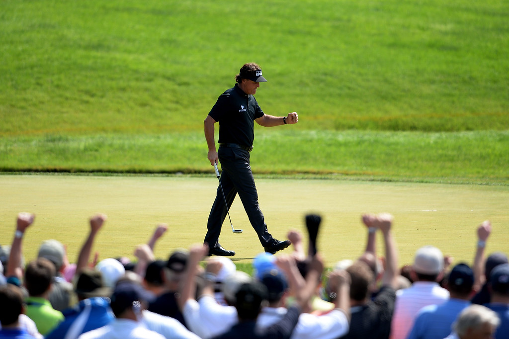 . Phil Mickelson of the United States celebrates making a putt for birdie on the ninth hole during Round One of the 113th U.S. Open at Merion Golf Club on June 13, 2013 in Ardmore, Pennsylvania.  (Photo by Ross Kinnaird/Getty Images)