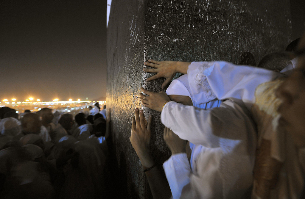 . Muslim pilgrims pray on Mount Arafat, near the holy city of Mecca, ahead of the hajj main ritual, on October 14, 2013. Vast crowds of Muslim pilgrims, all dressed in white, flocked from early in the morning to Mount Arafat in Saudi Arabia\'s west to take part in the main rituals of the annual hajj.  AFP PHOTO/FAYEZ NURELDINE/AFP/Getty Images