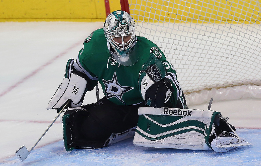 . Dan Ellis #30 of the Dallas Stars makes a save against the Colorado Avalanche at American Airlines Center on December 17, 2013 in Dallas, Texas.  (Photo by Ronald Martinez/Getty Images)