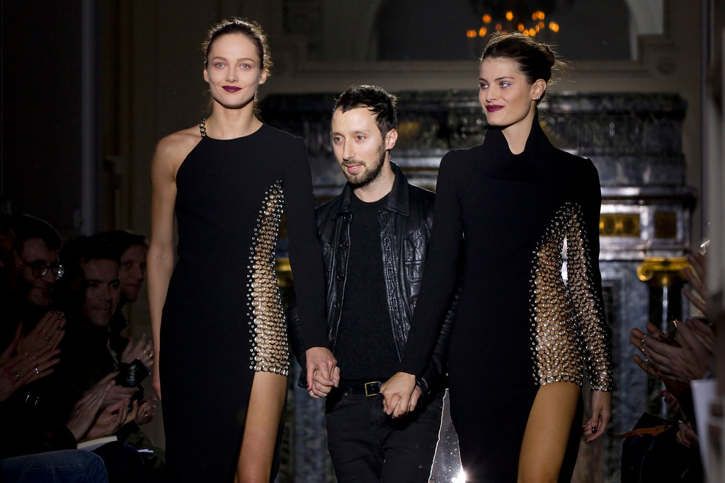 . Designer Anthony Vaccarello (C) appears at the end of his Fall-Winter 2013/2014 women\'s ready-to-wear fashion show during Paris fashion week February 26, 2013.  REUTERS/Gonzalo Fuentes