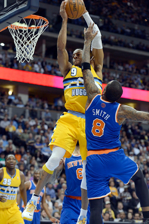 . Andre Iguodala (9) of the Denver Nuggets pulls a rebound away from J.R. Smith (8) of the New York Knicks during the second quarter March 13, 2013 at Pepsi Center. (Photo By John Leyba/The Denver Post)