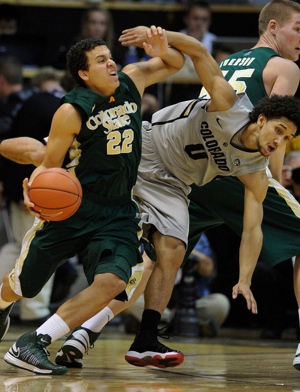 . Rams guard Dorian Green (22) tried to get around Buffs defender Askia Booker (0) in the first half. The University of Colorado men\'s basketball team hosted Colorado State University inside the Coors Events Center Wednesday night, November 5, 2012. Karl Gehring/The Denver Post