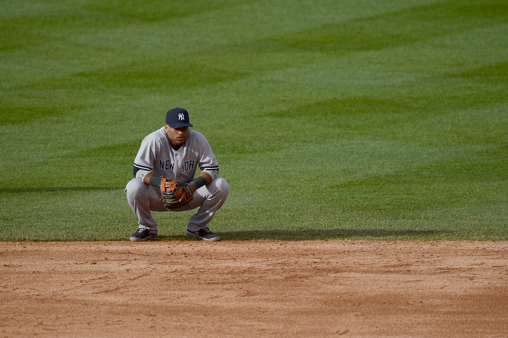 . Robinson Cano (24) of the New York Yankees squats on the edge of the infield grass against the Colorado Rockies May 9, 2013 at Coors Field. (Photo By John Leyba/The Denver Post)