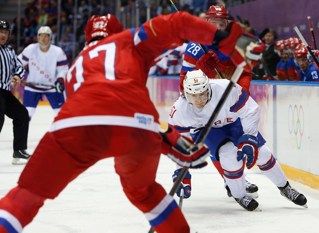 . Norway forward Mats Olsen Rosseli looks to intercept a pass by Russia defenseman Anton Belov in the first period of a men\'s ice hockey game at the 2014 Winter Olympics, Tuesday, Feb. 18, 2014, in Sochi, Russia. (AP Photo/Mark Humphrey)