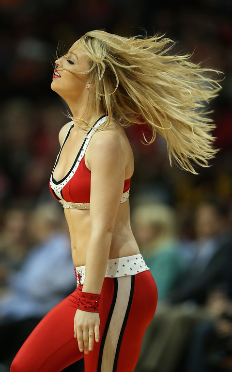 ". A member of the Chicago Bulls dance team ""The Luvabulls\"" performs during a break between the Bulls and the Denver Nuggets during a preseason game at the United Center on October 25, 2013 in Chicago, Illinois. The Bulls defeated the Nuggets 94-89. (Photo by Jonathan Daniel/Getty Images)"