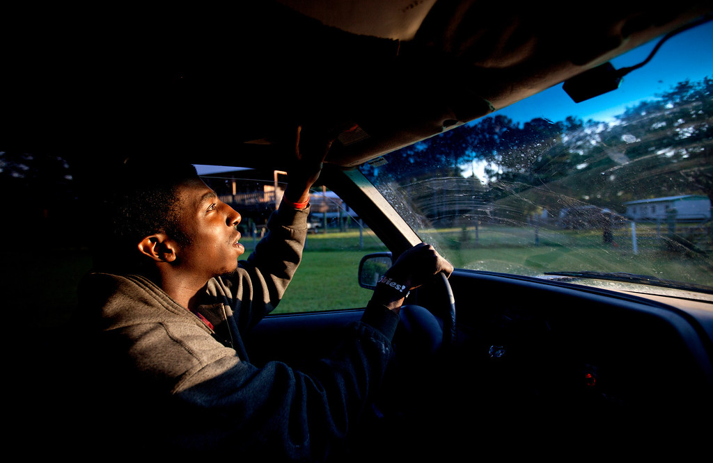 . Kyle Alexander, 20, drives to his construction job working at a new vacation home being built for a couple from the Northeast, in the Hog Hammock community of Sapelo Island, Ga. on Wednesday, May 15, 2013. Alexander is one of roughly 47 residents, most of them descendants of West African slaves known as Geechee, who remain on the coastal Georgia island where their ancestors were brought to work a plantation in the early 1800s. Isolated over time to the Southeast\'s barrier islands, the Geechee of Georgia and Florida, otherwise known as Gullah in the Carolinas, have retained their African traditions more than other African American communities in the U.S. Once freed, the slaves were able to acquire land and created settlements on the island, of which only the tiny 464-acre Hog Hammock community still exists. Residents say a sudden tax hike, lack of jobs, and development is endangering one of the last remaining Geechee communities from Florida to North Carolina. (AP Photo/David Goldman)