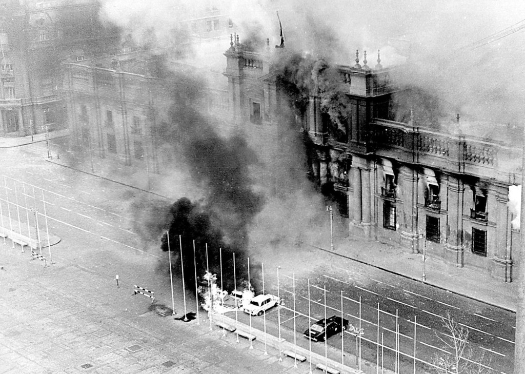 . In this Sept. 11, 1973 file photo, smoke rises from La Moneda presidential palace after being bombed during a military coup led by Gen. Augusto Pinochet that overthrew President Salvador Allende in Santiago, Chile.  On Sept. 11, 2013, Chile marks the 40th anniversary of the coup.  (AP Photo/El Mercurio, File)