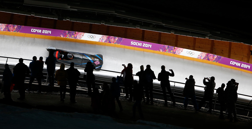 . Fans watch Germany head down the Two-man Bobsleigh at the Sanki Sliding Center for the 2014 Winter Olympics in Krasnaya Polyana, Russia, on Sunday, Feb. 16, 2014.  (Nhat V. Meyer/Bay Area News Group)