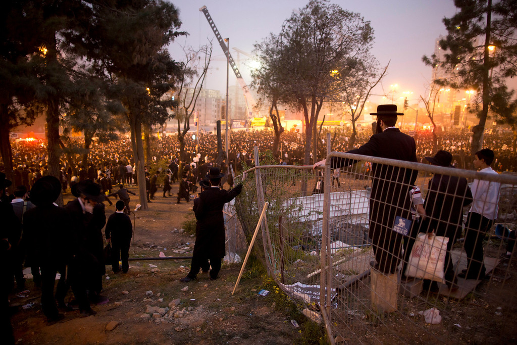 . Hundreds of thousands of ultra-Orthodox Jews rally in a massive show of force against plans to force them to serve in the Israeli military, blocking roads and paralyzing the city of Jerusalem, Sunday, March 2, 2014. The widespread opposition to the compulsory draft poses a challenge to the country, which is grappling with a cultural war over the place of the ultra-Orthodox in Israeli society. With secular Jews required to serve, the issue is one of the most sensitive flashpoints between Israel\'s secular majority and its devout minority. (AP Photo/Oded Balilty)