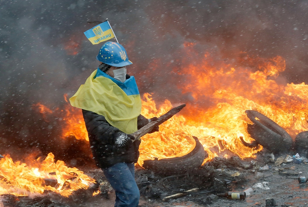 . A protester in central Kiev, Ukraine, Wednesday, Jan. 22, 2014. (AP Photo/Efrem Lukatsky)