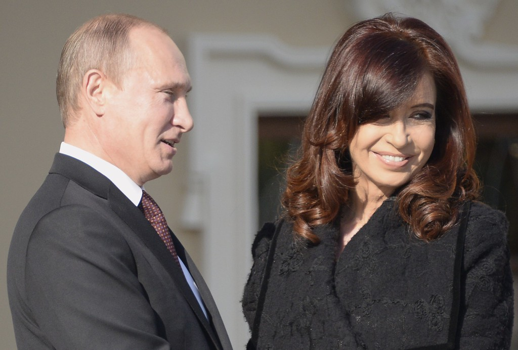 . Russias President Vladimir Putin (R) welcomes Argentinas President Cristina Fernandez de Kirchner at the start of the G20 summit on September 5, 2013 in Saint Petersburg.       AFP PHOTO / ALEXANDER NEMENOV/AFP/Getty Images