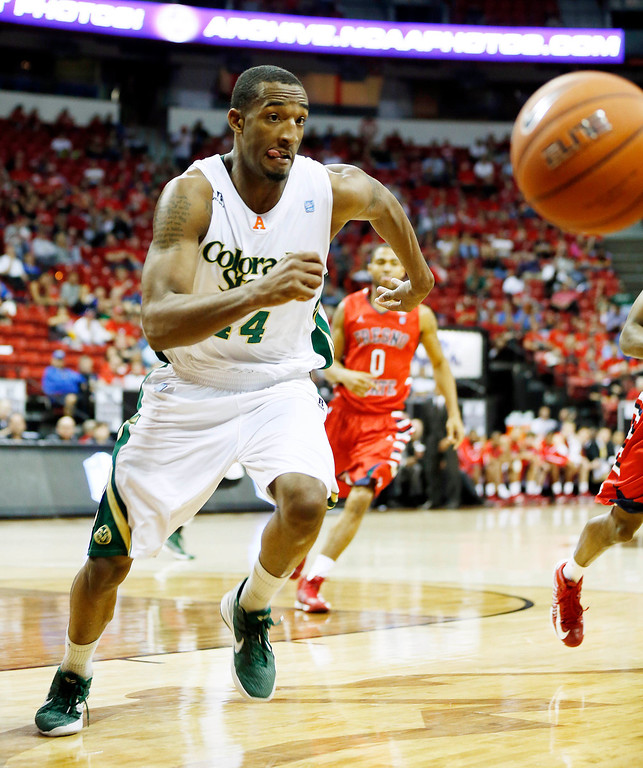 . Colorado State\'s Greg Smith goes after a loose ball during the second half of a Mountain West Conference tournament NCAA college basketball game against Fresno State, Wednesday, March 13, 2013, in Las Vegas. Colorado State defeated Fresno State 67-61. (AP Photo/Isaac Brekken)