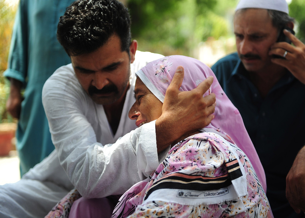 . Pakistani relatives mourn missing family members following an assault by militants at Karachi airport terminal in Karachi on June 9, 2014. Twenty-eight people were killed as Pakistan\'s military fought an all-night battle with Taliban gunmen who besieged Karachi airport armed with rocket launchers and suicide vests, leaving a nascent peace process in tatters. Ten militants were among the dead, officials said, as Pakistan\'s biggest city witnessed a return of the kind of spectacular offensive waged before by the Tehreek-e-Taliban Pakistan (TTP) during an insurgency that has claimed thousands of lives since 2007. AFP PHOTO/Rizwan  TABASSUM/AFP/Getty Images
