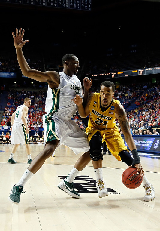 . LEXINGTON, KY - MARCH 21:  Laurence Bowers #21 of the Missouri Tigers drives against Greg Smith #44 of the Colorado State Rams during the second round of the 2013 NCAA Men\'s Basketball Tournament at the Rupp Arena on March 21, 2013 in Lexington, Kentucky.  (Photo by Kevin C. Cox/Getty Images)