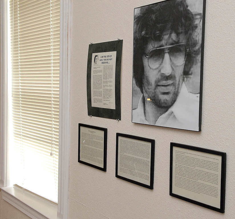 . A photo of former Branch Davidian leader David Koresh hangs on a wall at the one-room chapel on the site of the Branch Davidian Compound near Waco, Texas, Monday April 9, 2007. Residents living on the grounds are undertaking major renovations of the land in a effort to seek new followers and change the image of the sect. (AP Photo/Rod Aydelotte)