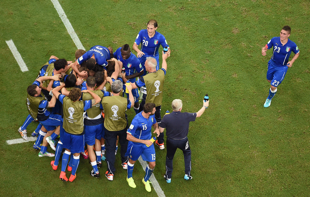 . The Italian team celebrate scoring the opening goal during the group D World Cup soccer match between England and Italy at the Arena da Amazonia in Manaus, Brazil, Saturday, June 14, 2014.  (AP Photo/Francois Xavier Marit, pool)