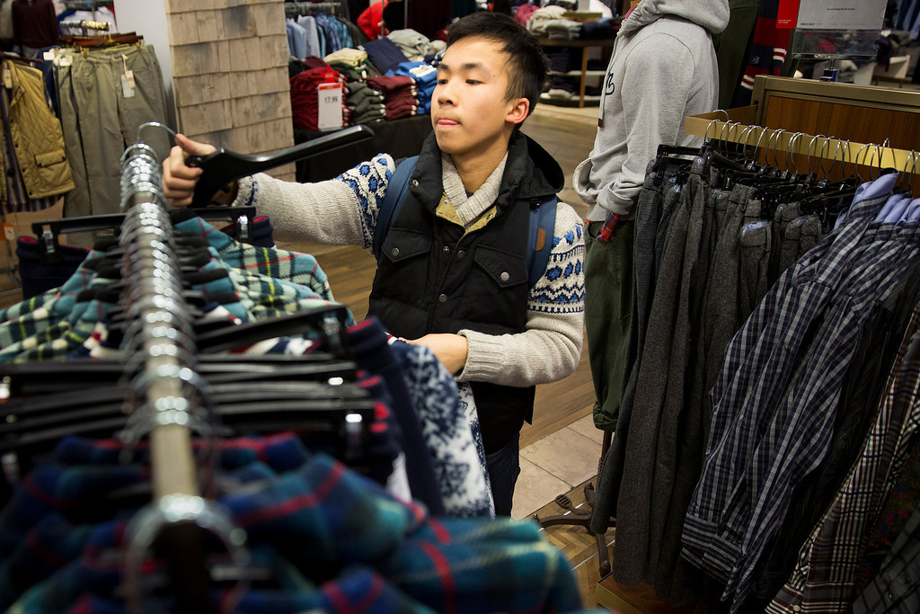 . Kevin Zeng, of Milwaukee, Wis., shops for clothing on Black Friday at Macy\'s on Friday, Nov. 29, 2013, in Chicago. Black Friday, the day after Thanksgiving, is typically the nation\'s biggest shopping day of the year. (AP Photo/Andrew A. Nelles)
