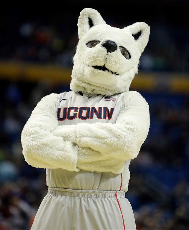 . Connecticut\'s mascot poses during the first half of a second-round game against Saint Joseph\'s in the NCAA college basketball tournament in Buffalo, N.Y., Thursday, March 20, 2014. (AP Photo/Nick LoVerde)