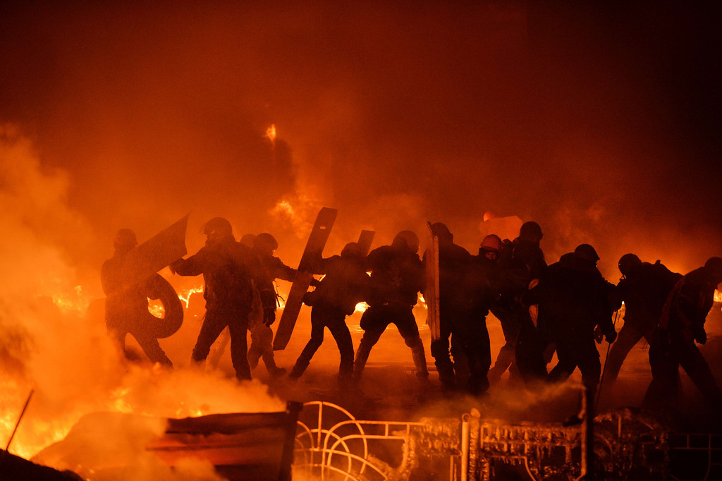 . Anti-government protesters clash with the police in the center of Ukrainian capital Kiev during the night on  January 25, 2014. Violence broke out in Kiev again late Friday, with molotov cocktails flying in one direction and stun grenades in the other, but both sides stuck to their positions and the flare-up did not escalate into the running  SUPINSKY/AFP/Getty Images