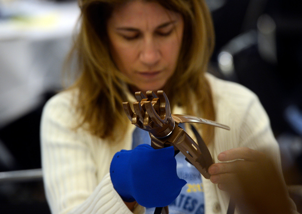. DENVER, CO. - APRIL 27: Luann Regensburg assembles a prosthetic hand at the Colorado Convention Center in Denver, CO April 27, 2013. Over 4,000 volunteers from DaVita HealthCare Partners took part in the Odyssey Teams �Helping Hands� program, assembling 1,400 prosthetic hands. LN-4 created, and will distribute the prosthetic hands to amputees in over 60 developing countries. (Photo By Craig F. Walker/The Denver Post)