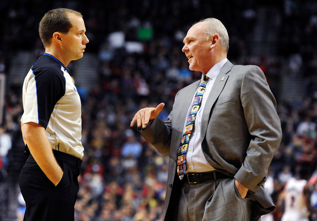 . Denver Nuggets head coach George Karl (R) speaks with referee John Goble during the first quarter of their NBA basketball game against the Portland Trail Blazers in Portland, Oregon, February 27, 2013.  REUTERS/Steve Dykes