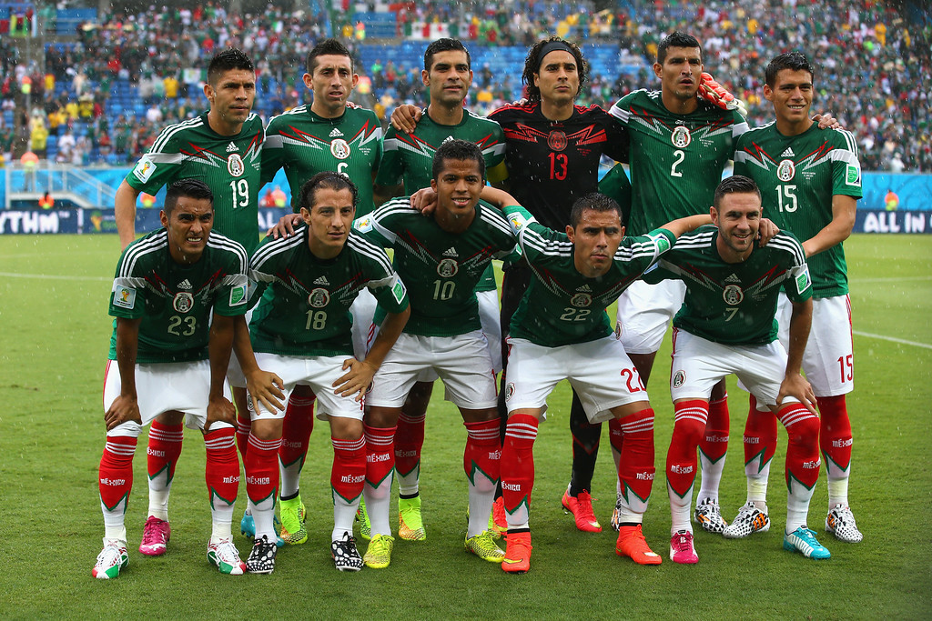 . Mexico players pose for a team photo before the 2014 FIFA World Cup Brazil Group A match between Mexico and Cameroon at Estadio das Dunas on June 13, 2014 in Natal, Brazil.  (Photo by Julian Finney/Getty Images)