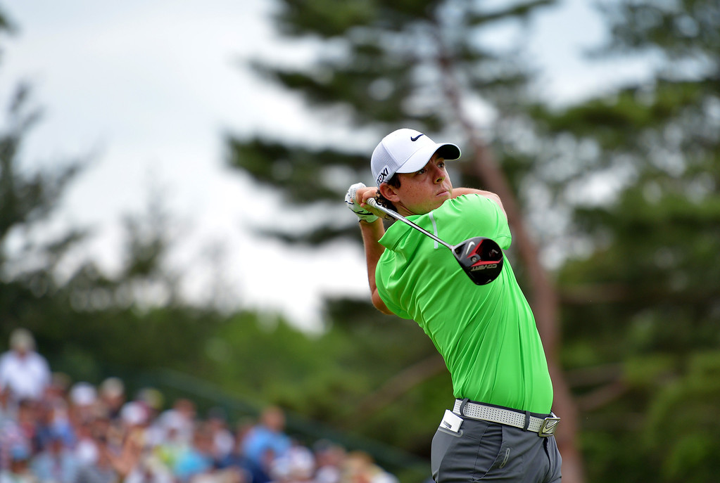 . ARDMORE, PA - JUNE 16: Rory McIlroy of Northern Ireland hits his tee shot on the fourth hole during the final round of the 113th U.S. Open at Merion Golf Club on June 16, 2013 in Ardmore, Pennsylvania.  (Photo by Drew Hallowell/Getty Images)