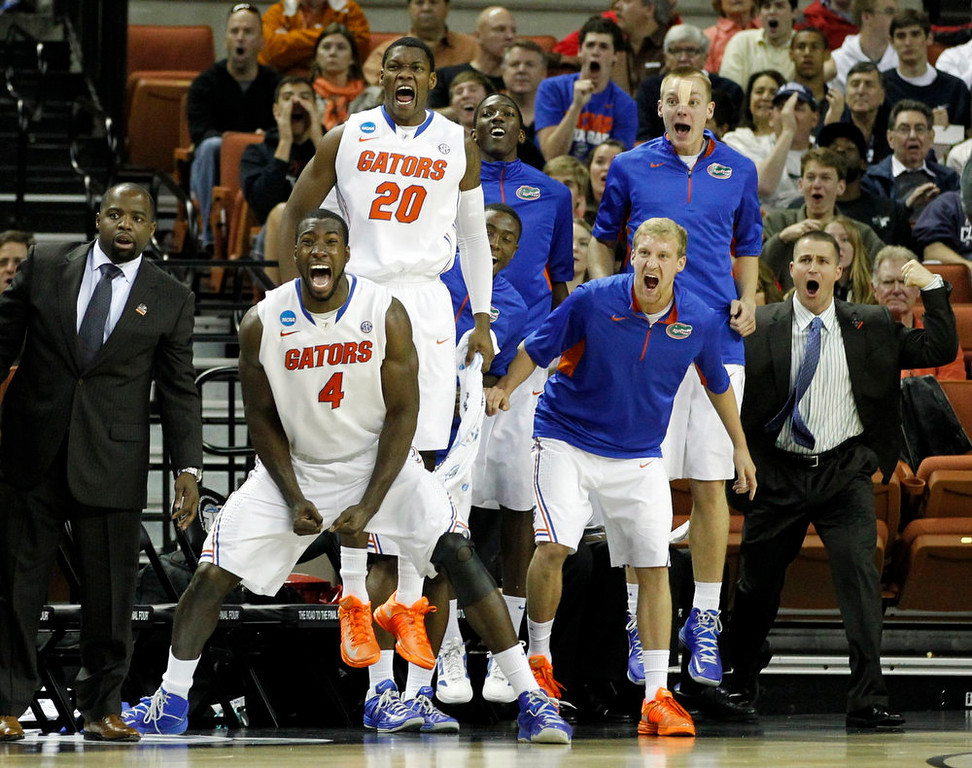 . The University of Florida bench reacts against the University of Minnesota during the first half of their third round NCAA basketball game in Austin, Texas March 24, 2013.  REUTERS/Mike Stone