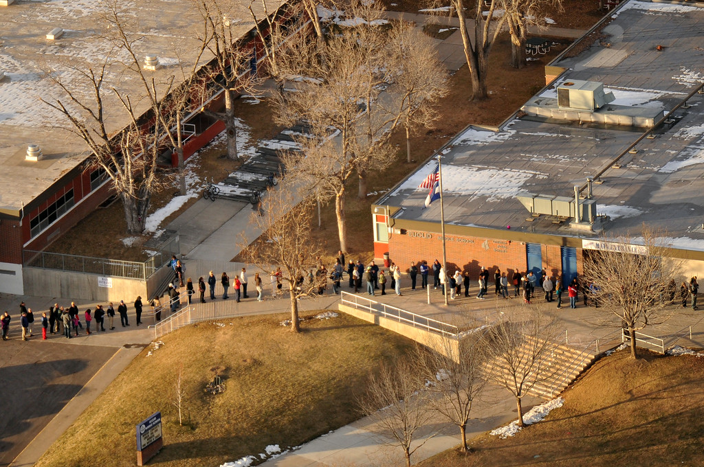 . Centennial, CO. DECEMBER 13: People line up out side of Euclid Middle School, one of the reunification centers, with their families following a shooting incident at Arapahoe High School in Centennial, Colorado. December 13. 2013. (Photo by Hyoung Chang/The Denver Post)