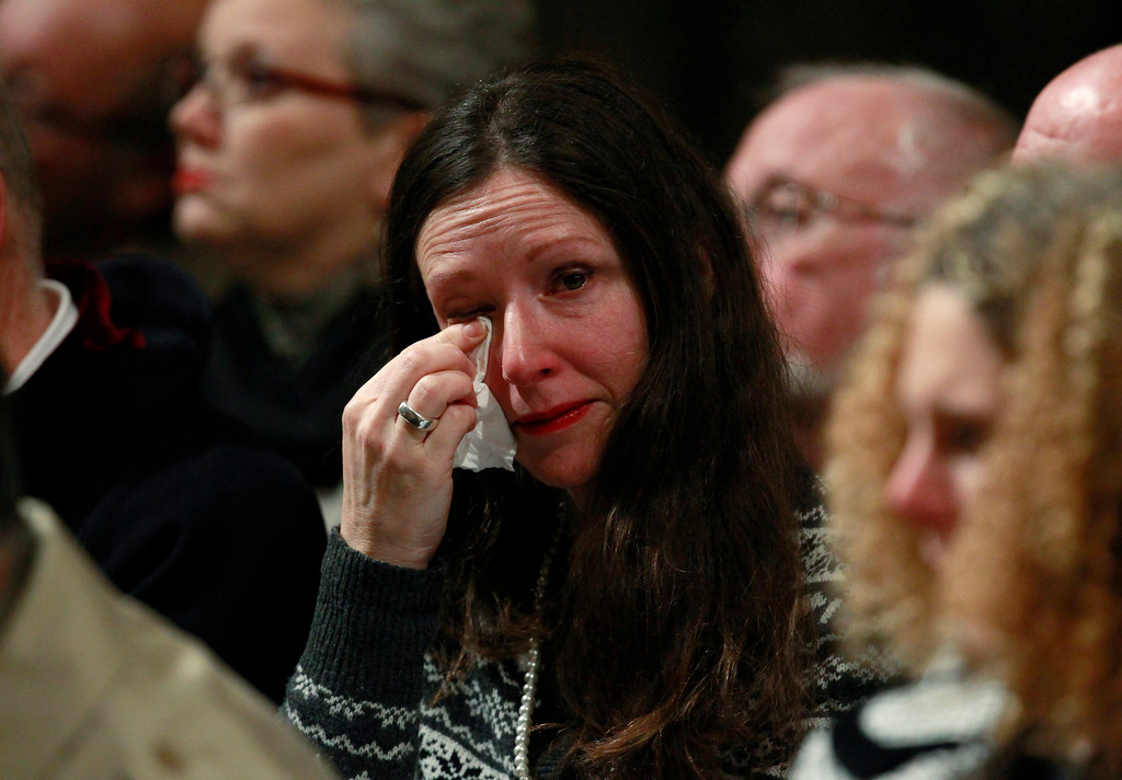 ". A woman wipes her eye during a service of remembrance to mark the 25th anniversary of the Lockerbie air disaster at Westminster Abbey in London on December 21, 2013. Britain, the United States and Libya issued a joint call Saturday for justice over the Lockerbie bombing as services were held to mark the 25th anniversary of the attack, which claimed 270 lives. The three governments gave their ""deepest condolences\"" to relatives of those who died when Pan Am Flight 103 blew up over the Scottish town of Lockerbie on December 21, 1988, en route from London to New York.  AFP PHOTO / POOL / LUKE MACGREGOR/AFP/Getty Images"