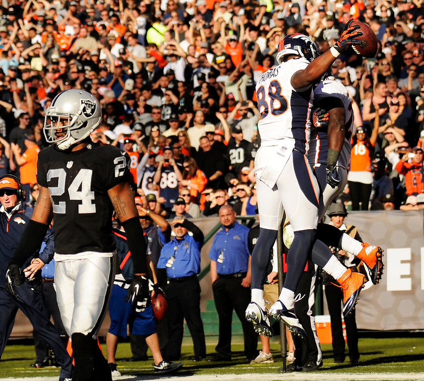 . Wide receiver Demaryius Thomas (88) celebrates his score with running back Montee Ball (28) that broke the season passing yardage record against the Oakland Raiders at O.co Coliseum December 29, 2013 Oakland, Calif. (Photo By Joe Amon/The Denver Post)