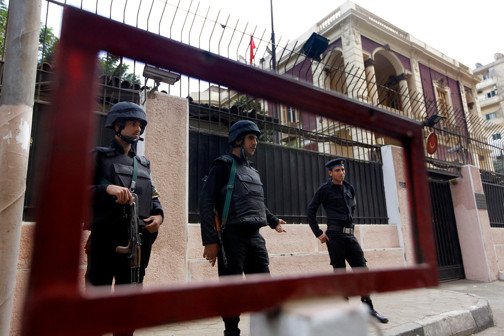 . Egyptian policemen guard the Turkish embassy in Cairo, Egypt, Saturday, Nov. 23, 2013.  Egypt downgraded diplomatic relations Saturday with Turkey and expelled its ambassador from Cairo, a sharp escalation in tensions between the two countries that mounted after a military coup ousted the country\'s Islamist president this summer. (AP Photo/Amr Nabil)