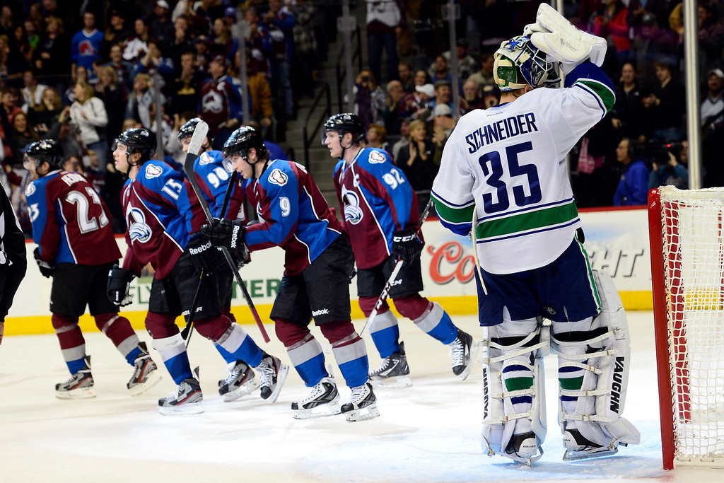 . DENVER, CO - MARCH 24: Cory Schneider (35) of the Vancouver Canucks reacts to giving up a 3-2 goal to P.A. Parenteau (15) of the Colorado Avalanche during the third period of action. The Colorado Avalanche lost to the Vancouver Canucks 3-2 at the Pepsi Center. (Photo by AAron Ontiveroz/The Denver Post)