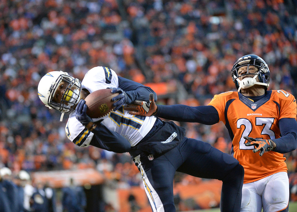 . San Diego Chargers wide receiver Keenan Allen (13) catches a pass for a touchdown in the fourth quarter. The Denver Broncos take on the San Diego Chargers at Sports Authority Field at Mile High in Denver on January 12, 2014. (Photo by Hyoung Chang/The Denver Post)