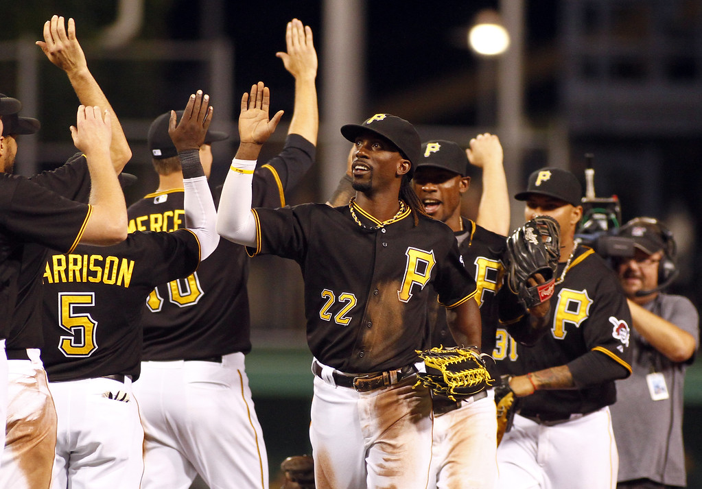 . PITTSBURGH, PA - AUGUST 03:  Andrew McCutchen #22 of the Pittsburgh Pirates celebrates with teammates after defeating the against the Colorado Rockies 5-2 on August 3, 2013 at PNC Park in Pittsburgh, Pennsylvania.  (Photo by Justin K. Aller/Getty Images)