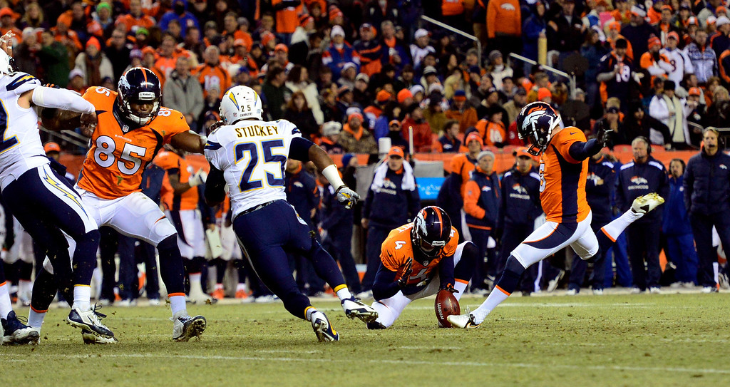 . DENVER, CO - DECEMBER 12: Denver Broncos kicker Matt Prater (5) kicks a 35 yard field goal in the first quarter bring the Broncos score to 10.  The Denver Broncos vs. the San Diego Chargers at Sports Authority Field at Mile High in Denver on December 12, 2013. (Photo by AAron Ontiveroz/The Denver Post)