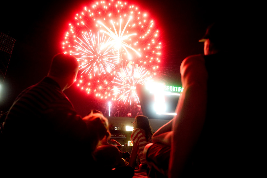 . DENVER - JULY 4: Spectators watch the Independence Day fireworks show after an MLS soccer match between the Colorado Rapids and the New York Red Bulls on July 4, 2013 at Dick\'s Sporting Goods Park. The Rapids defeated the Red Bulls 2-0. (Photo By Grant Hindsley / The Denver Post)