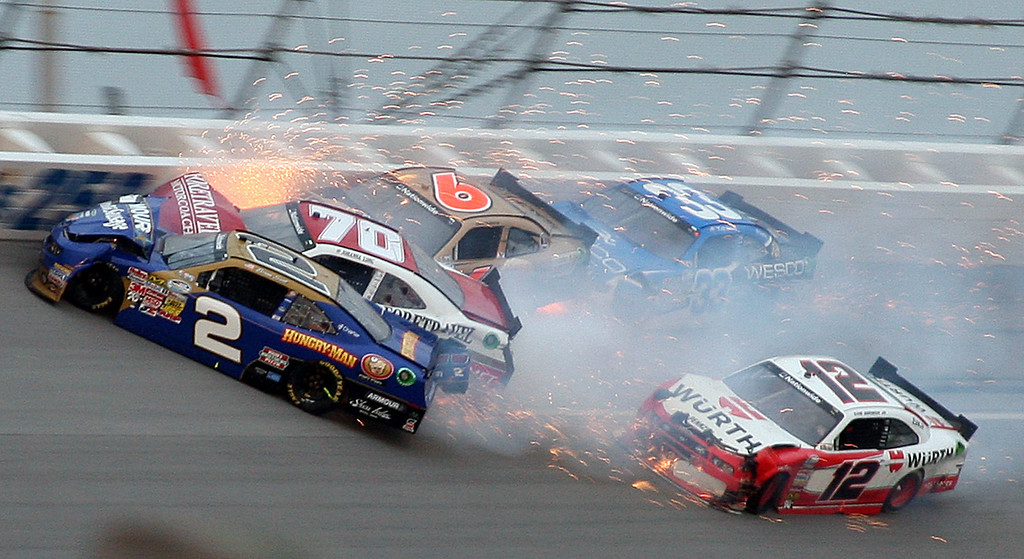 . Brian Scott (2) crashes with Johanna Long (70), Trevor Bayne (6), Ty Dilon (33) and Sam Hornish Jr. (12) in Turn 3 during the NASCAR Nationwide Series auto race at the Talladega Superspeedway in Talladega, Ala., Saturday, May 4, 2013. (AP Photo/Dale Davis)