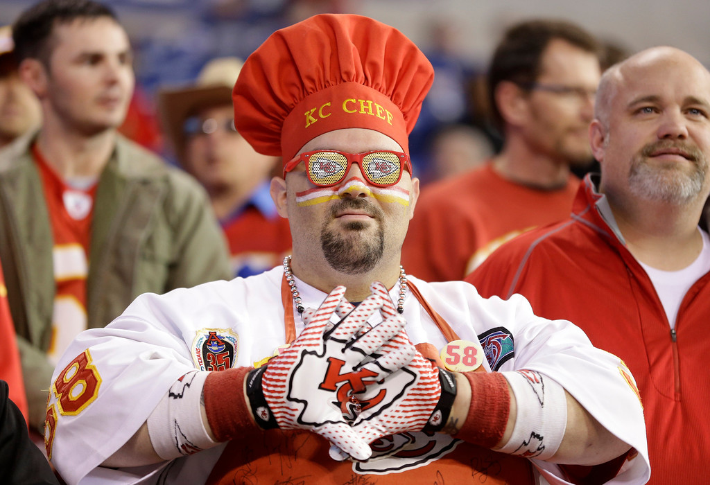 . A Kansas City Chiefs fans watches during warm-ups before an NFL wild-card playoff football game against the Indianapolis Colts Saturday, Jan. 4, 2014, in Indianapolis. (AP Photo/Michael Conroy)
