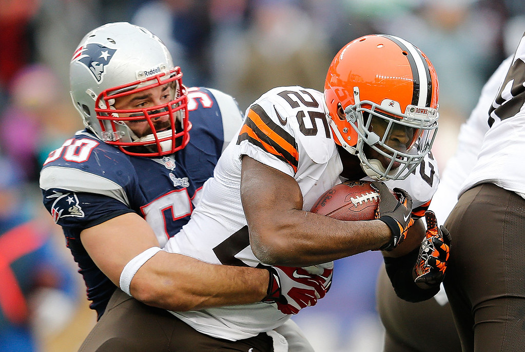 . Rob Ninkovich #50 of the New England Patriots brings down Chris Ogbonnaya #25 of the Cleveland Browns in the first half at Gillette Stadium on December 8, 2013 in Foxboro, Massachusetts. (Photo by Jim Rogash/Getty Images)