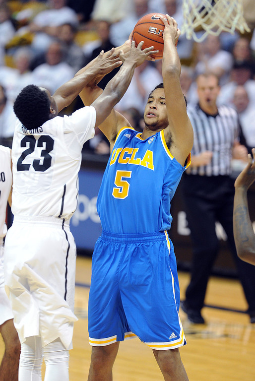 . Kyle Anderson of UCLA tries to shoot over Jaron Hopkins of CU during the first half of the January 16, 2014 game in Boulder.  (Cliff Grassmick/Daily Camera)