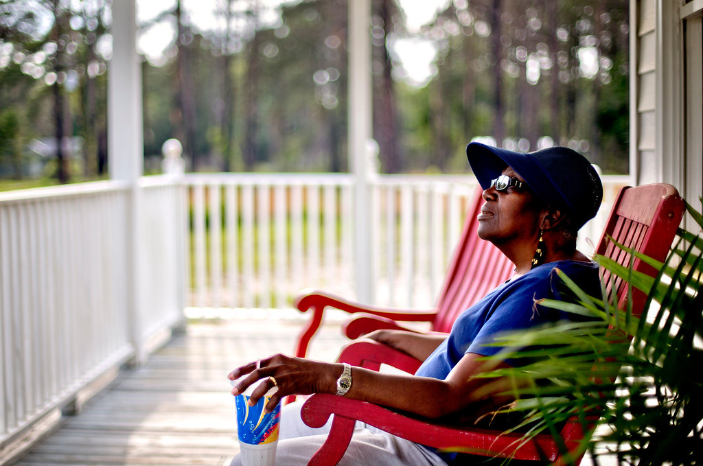 """. Cornelia Bailey sits on the front porch of the Sapelo Island Cultural and Revitalization Society in the Hog Hammock community of Sapelo Island, Ga. on Thursday, May 16, 2013. \""""You can\'t have a Geechee Gullah Corridor without the preservation of the Geechee-Gullah people,\"""" she says. \""""They need to make sure the Geechee-Gullah people keep this land. This fight is not for us. The fight is for the next generation.\"""" (AP Photo/David Goldman)"""
