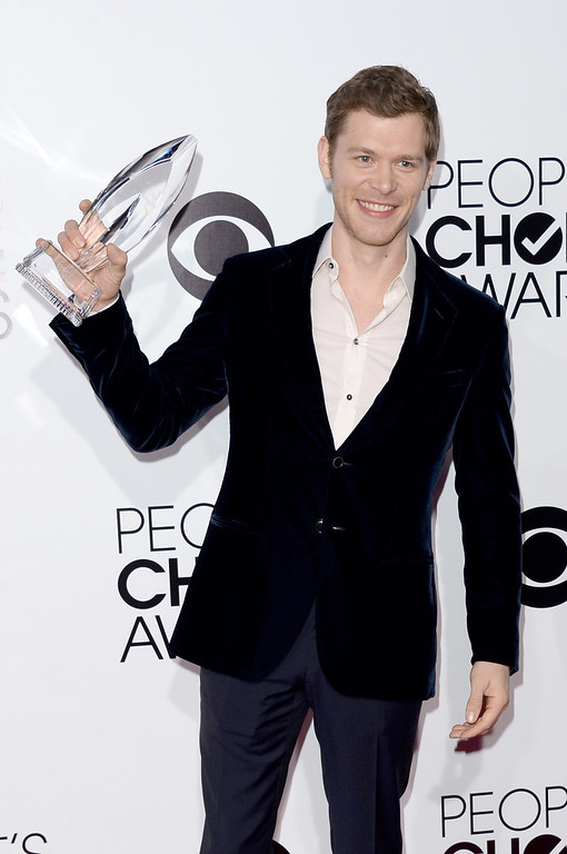 ". LOS ANGELES, CA - JANUARY 08:  Actor Joseph Morgan, winner of the Favorite Actor In A New TV Series award for ""The Originals,\"" poses in the press room at The 40th Annual People\'s Choice Awards at Nokia Theatre L.A. Live on January 8, 2014 in Los Angeles, California.  (Photo by Jason Merritt/Getty Images)"